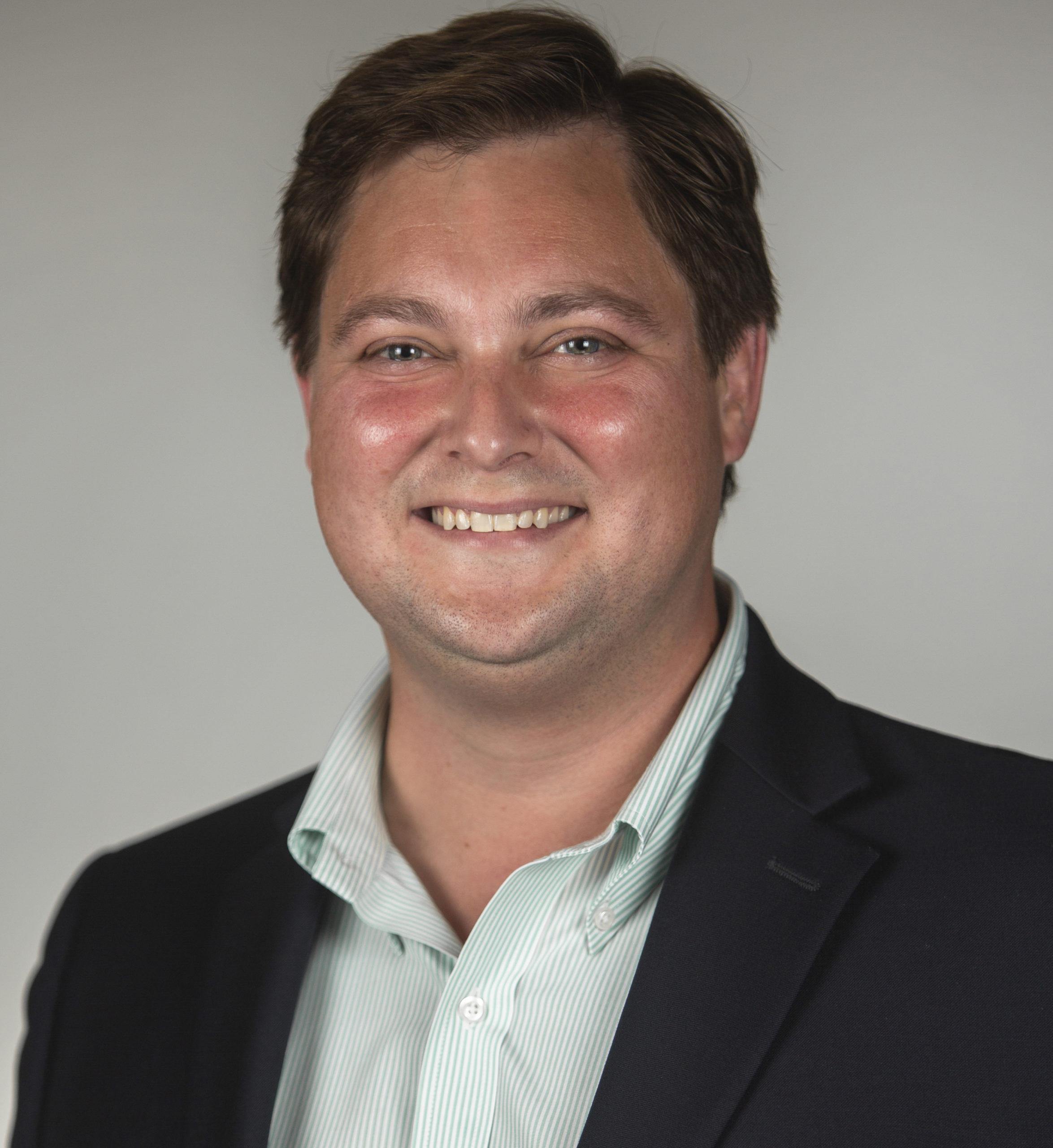 Professional headshot of Glenn Person