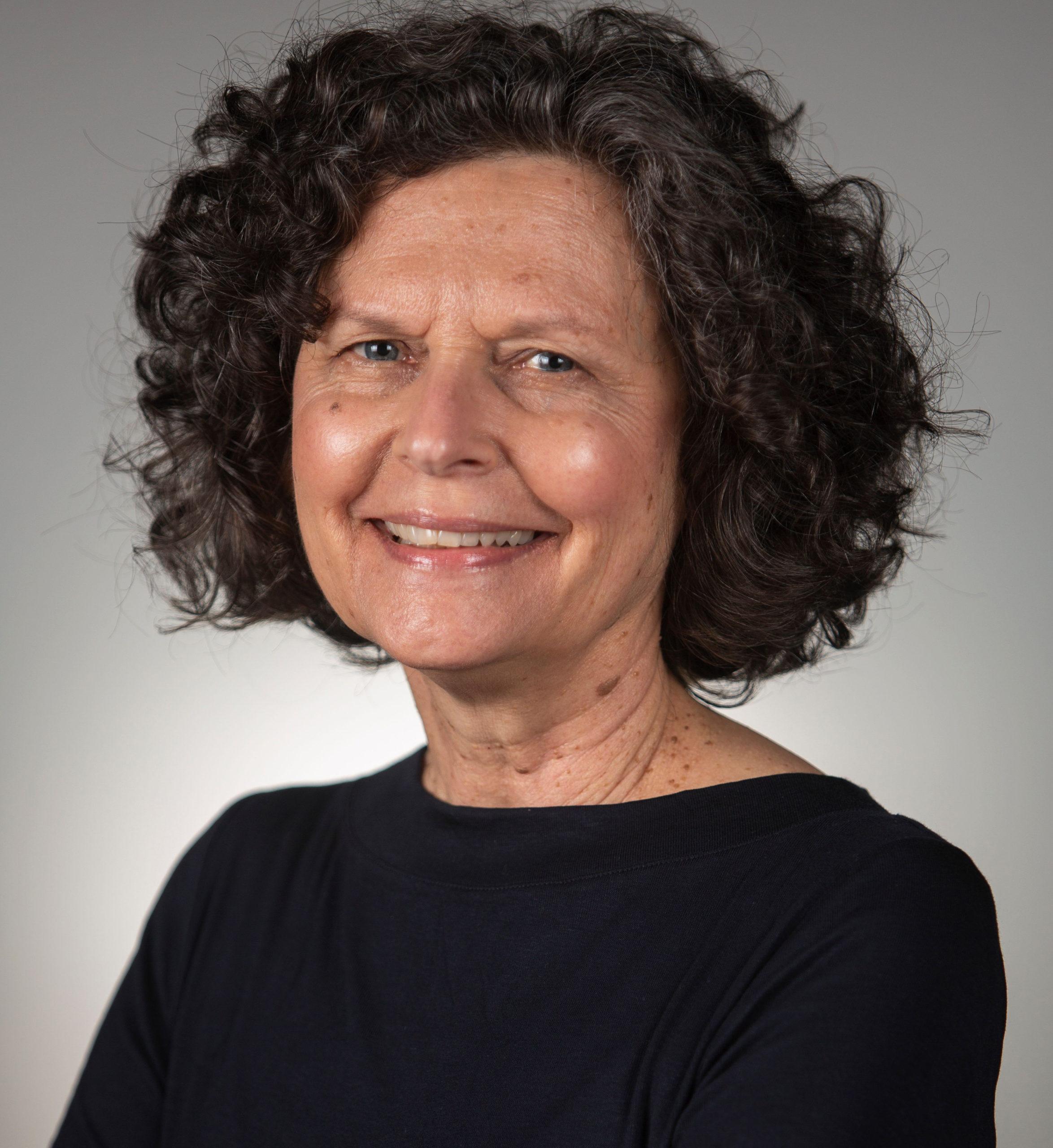 Professional headshot of Julie Buchanan